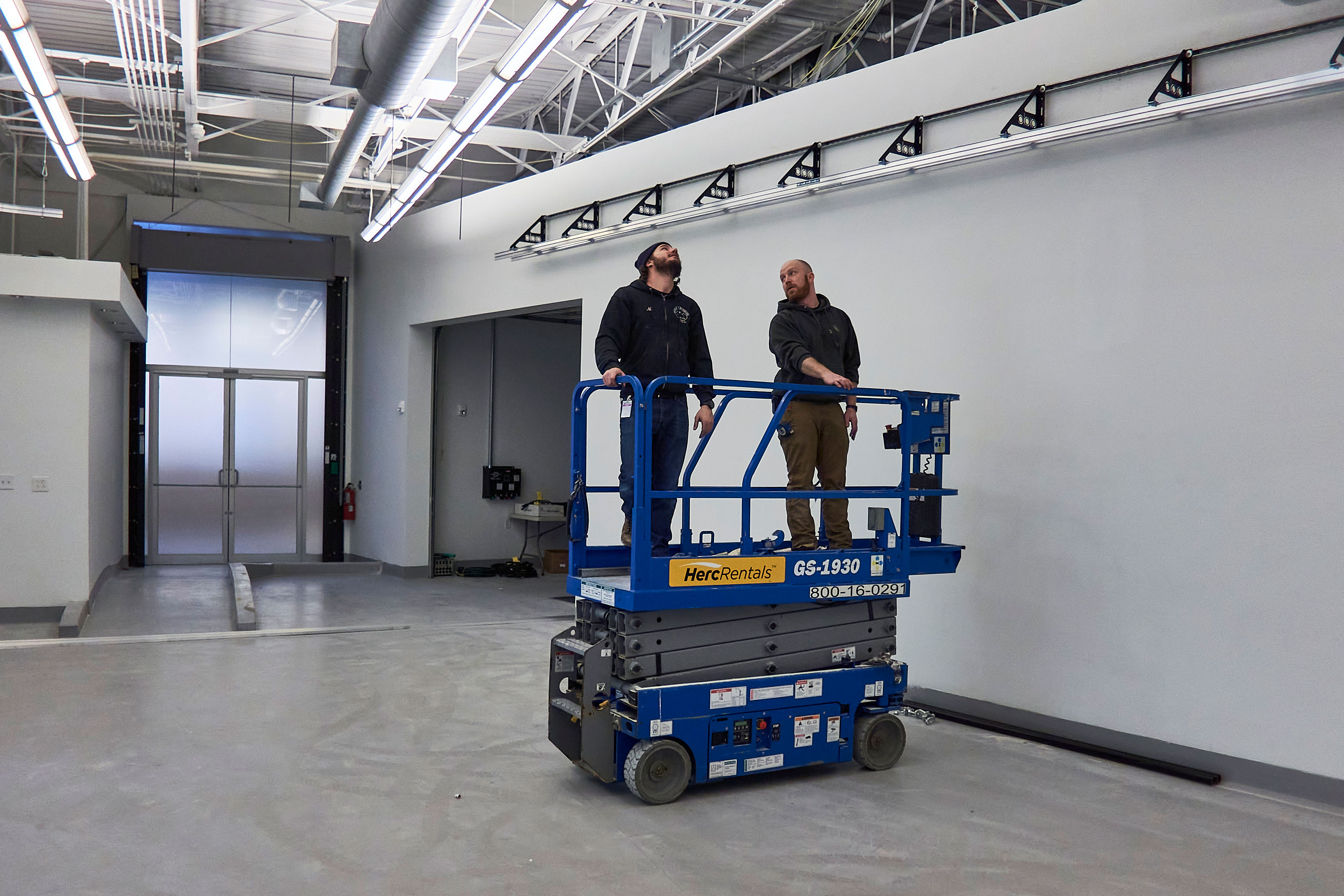 Men Consulting on a Studio Installation
